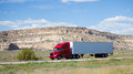 Semi truck on the road in the desert a Royalty Free Stock Photography