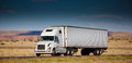 Semi truck on the road in the desert a Royalty Free Stock Photo