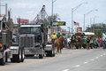 Semi trucks, horses and flags in a parade in small town America Royalty Free Stock Photo