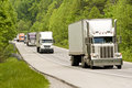 Trucks driving on divided roadway Royalty Free Stock Photo