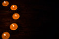 Semicircle of candles on a black background Royalty Free Stock Photo