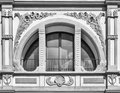Semicircle white window crossed by decorated columns in the shape of a Royalty Free Stock Images