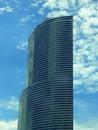 Semicircular blue glass skyscraper Stock Photo