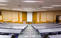 Seminar room empty conference with blank projector screen Stock Image