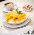 Semolina porridge with mango Stock Photo