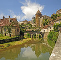 Semur en auxois castlel and river in the medieval burgundy town of Royalty Free Stock Photos