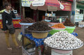 Sen monorom market cambodia woman selling fried insects in Stock Photo