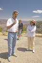 Senator John Kerry, with family,  speaking at rim of Bright Angel Lookout, Grand Canyon, AZ Royalty Free Stock Photo