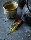 Sencha leaves on a sakura cherry bark tea spoon Royalty Free Stock Photo