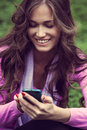 Send message smiling young woman sending on smartphone Royalty Free Stock Image