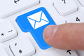 Sending e mail email mail message on computer keyboard with letter symbol Stock Photo