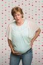 Senhora grávida having contractions Imagem de Stock Royalty Free
