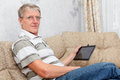 Senior adult man working with a new tablet device Royalty Free Stock Photography
