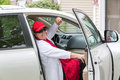 Senior adult on the passenger seat getting ready for trip lady with red hat sitting close door and hit road she has genuine smile Royalty Free Stock Image