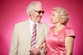 Senior affection affectionate seniors standing arm in arm and looking at each other Royalty Free Stock Photo