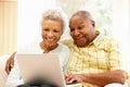 Senior african american couple using laptop Stock Image