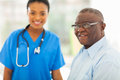 Senior african man doctors smiling american men in office with nurse on background Royalty Free Stock Image