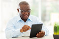 Senior african man tablet cheerful american using computer at home Stock Photo