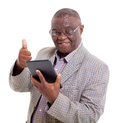 Senior african man tablet pc with giving thumb up on white background Stock Image