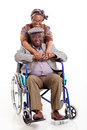 Senior african wife husband loving hugging disabled on white background Stock Photo