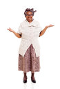 Senior african woman beautiful with open arms over white background Stock Photography