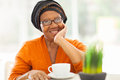 Senior african woman tea elegant having at home Stock Images