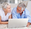 Senior aged couple browsing on a laptop Stock Image
