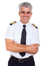 Senior airline captain portrait of handsome with arms crossed isolated on white background Stock Photo