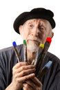 Senior artist with beret and brushes Stock Image
