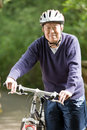 Senior asian biking Stock Images