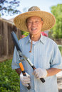 Senior Asian Gardener Working in Garden Stock Image
