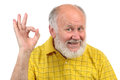 Senior bald man s gestures funny in yellow t shirt is shows and grimaces Royalty Free Stock Photos