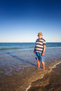 Senior on beach man walking the Royalty Free Stock Image