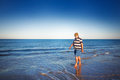 Senior on beach man walking the Royalty Free Stock Images