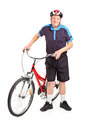 Senior bicyclist posing next to a bicycle Royalty Free Stock Photo