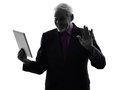 Senior business man holding digital tablet saluting silhouette one caucasian white background Stock Photos