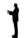 Senior business man holding digital tablet silhouette one caucasian white background Royalty Free Stock Photography