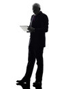 Senior business man holding digital tablet silhouette one caucasian white background Royalty Free Stock Images