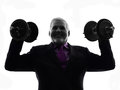 Senior business man holding weights silhouette one caucasian white background Stock Photography