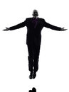 Senior business man jumping arms outstretched silhouette one caucasian white background Royalty Free Stock Image