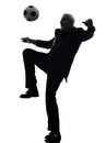 Senior business man playing soccer silhouette Royalty Free Stock Images