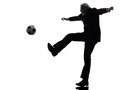 Senior business man playing soccer silhouette one caucasian white background Royalty Free Stock Image