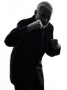 Senior business man punching the air silhouette silhouette one caucasian white background Royalty Free Stock Images