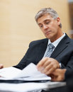 Senior business man reading through files at work Royalty Free Stock Photos