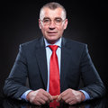 Senior business man with reading glasses sitting Royalty Free Stock Photo