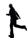 Senior business man running silhouette Royalty Free Stock Photos