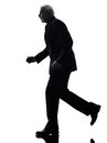 Senior business man running silhouette one caucasian white background Stock Photography