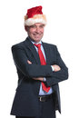 Senior business man in santa claus hat smiling with hands folded portrait of a happy Stock Images