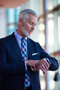 Senior business man talk on mobile phone at modern bright office interior Royalty Free Stock Photo