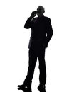 Senior business man on the telephone smiling silhouette one caucasian white background Royalty Free Stock Photos